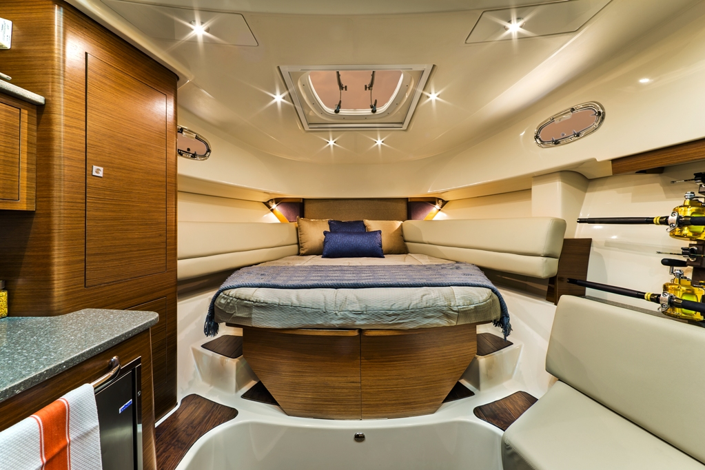 Sport fishing boat interior cabin with sleeping quarters, rod storage and kitchen